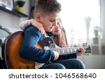 children playing electric...   Shutterstock . vector #1046568640