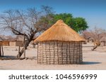 typical thatched roof african... | Shutterstock . vector #1046596999