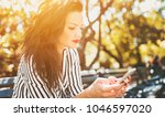 brunette woman siting in the... | Shutterstock . vector #1046597020