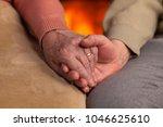 senior old hands holding in... | Shutterstock . vector #1046625610