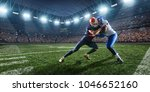 Small photo of American football players preforms an action play in professional sport stadium