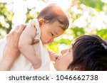 young father lift and playing...   Shutterstock . vector #1046662738