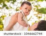 young father lift and playing...   Shutterstock . vector #1046662744