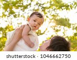 young father lift and playing...   Shutterstock . vector #1046662750