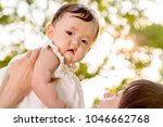 young father lift and playing...   Shutterstock . vector #1046662768
