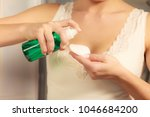 Small photo of Make up remove skin care. Closeup woman holding cotton swab and makeup remover liquid cosmetic in hands.