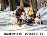 little girl sits on the sledge...   Shutterstock . vector #1046690458