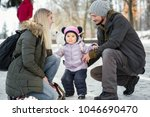 two young happy parents pose...   Shutterstock . vector #1046690470