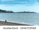 a long stony beach with... | Shutterstock . vector #1046723968