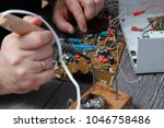 the master on repair of the... | Shutterstock . vector #1046758486