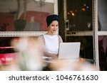 a young muslim woman wearing a... | Shutterstock . vector #1046761630