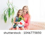 happy family mom received as a...   Shutterstock . vector #1046775850