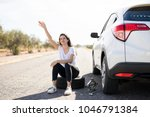 woman with flat tyre on her car ... | Shutterstock . vector #1046791384
