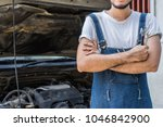 fixing car engine in automobile ... | Shutterstock . vector #1046842900