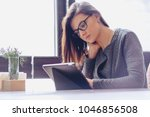 the girl in the glasses is...   Shutterstock . vector #1046856508