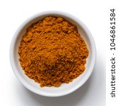 Small photo of Ground ground masala spice mix in white ceramic bowl isolated on white from above.