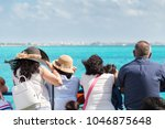 group of travelers looking out...   Shutterstock . vector #1046875648