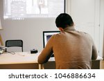 young man freelancer in a...   Shutterstock . vector #1046886634