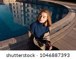 young blond model girl in blue... | Shutterstock . vector #1046887393