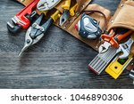 leather tool belt construction... | Shutterstock . vector #1046890306