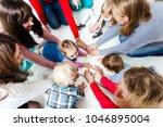 children in the circle | Shutterstock . vector #1046895004
