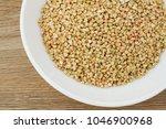 green buckwheat on the white... | Shutterstock . vector #1046900968