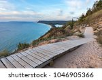 A Weathered Wooden Walkway On...