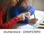 exercising together on homework | Shutterstock . vector #1046915893