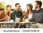 group of four friends having a... | Shutterstock . vector #1046920819