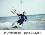 kitesurfing kiteboarding action ... | Shutterstock . vector #1046923264