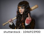 Small photo of lawbreaker, adolescence and delinquency, brunette woman in leather jacket and baseball bat with challenging aptitude