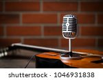 vintage silver microphone and... | Shutterstock . vector #1046931838