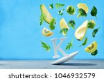 flying foods rich in vitamin k. ... | Shutterstock . vector #1046932579