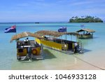 landscape view polynesian boats ...   Shutterstock . vector #1046933128