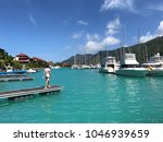 man at marina of eden island ... | Shutterstock . vector #1046939659