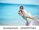 happy father and his adorable...   Shutterstock . vector #1046957464