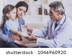 male pediatrician is  checking... | Shutterstock . vector #1046960920