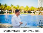 working on laptop from the...   Shutterstock . vector #1046962408