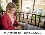business woman is working on...   Shutterstock . vector #1046982220