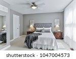 bedroom old fashioned interior | Shutterstock . vector #1047004573