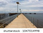 the new and old jetty at rapid...   Shutterstock . vector #1047014998