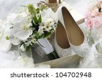 Bridal bouquet and bride shoes. - stock photo