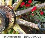 A Vintage Wagon Wheel Provides...