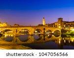the ponte pietra has the adige... | Shutterstock . vector #1047056566