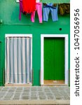 colorful house in burano island ... | Shutterstock . vector #1047056956