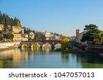 ponte pietra bridge on adige... | Shutterstock . vector #1047057013