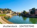 city of verona with adige river ... | Shutterstock . vector #1047057040
