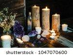 mystical altar amethyst candles | Shutterstock . vector #1047070600