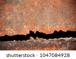 old rail irons are rusty and... | Shutterstock . vector #1047084928
