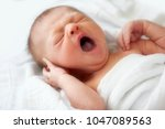 Yawning Newborn Baby Infant Is...